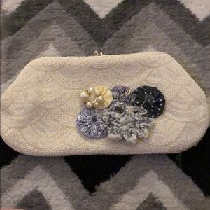 Small beaded clutch w/fabric flowers on front